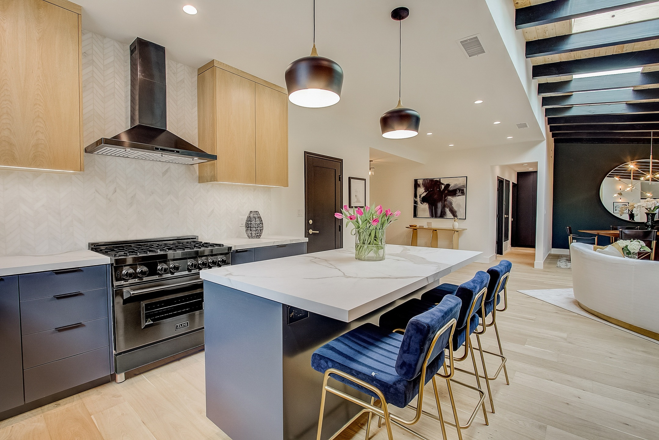 kitchen with white walls and contrasting blue tones
