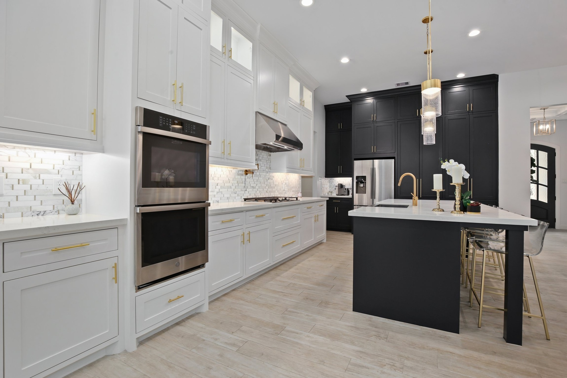 kitchen in white with wood flooring