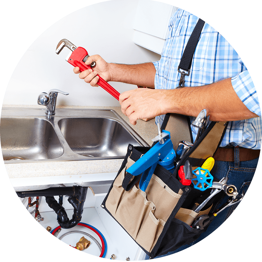 Picture of a plumber holding a monkey wrench
