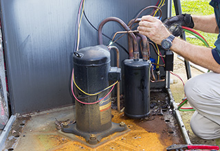 HVAC Tech Working on AC Condenser