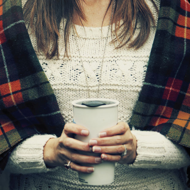 Woman Holding a Mug of Coffee in Winter