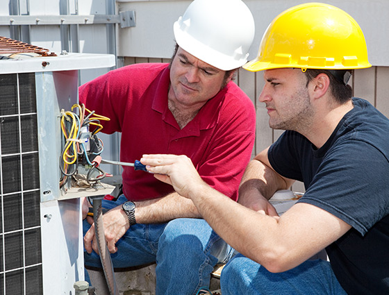 HVAC Technicians Checking AC Wiring