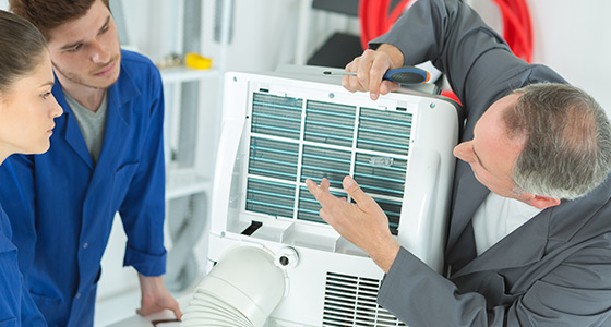 HVAC Technicians Examining Mini-Split AC