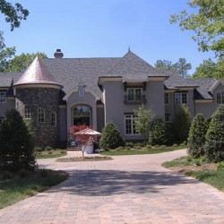 This grand driveway is the focus of this exterior home remodeling project by Home Services Direct in Chicago.