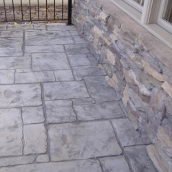 A variety of stone features bring natural beauty to this Chicago home remodeling project by Home Services Direct.