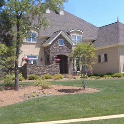 Simple landscaping complements this gorgeous home renovation project by Home Services Direct.