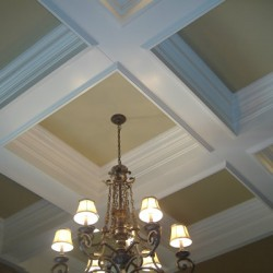 This geometric ceiling brings drama to this Chicago home renovation project by Home Services Direct.