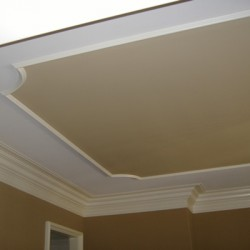 Beautiful ceiling details create a charming space in this house remodeling project by Home Services Direct.
