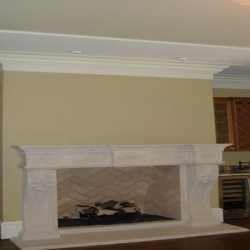 A dramatic fireplace adds character to this house remodeling project by Home Services Direct in Chicago.