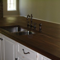 A large island lends storage and prep space to this Chicago kitchen remodel by Home Services Direct.