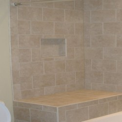 Gorgeous tile brings a clean look to this Chicago bathroom remodel by Home Services Direct.
