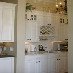 Home Services Direct completed this Chicago kitchen remodel with details like the wine rack and glass cabinet doors.