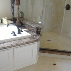 A combination of tile and stone brings character to this Chicago bathroom remodel by Home Services Direct.