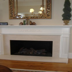This simple fireplace brings an elegant touch to this house remodeling project by Home Services Direct in Chicago.