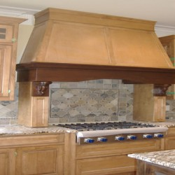 This dramatic range hood completes this Chicago kitchen remodel by Home Services Direct.