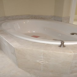 This long tub is the focal point of this Chicago bathroom remodel by Home Services Direct.