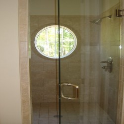 A massive shower completes this Chicago bathroom remodel by Home Services Direct.