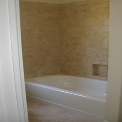 This Chicago bathroom remodel by Home Services Direct features a beautiful shower.