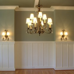 Matching wall lights and chandelier completes this Chicago home remodeling project by Home Services Direct.