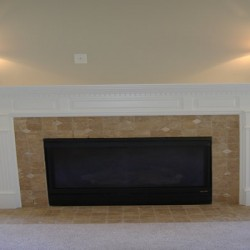 This fireplace design adds simple elegance to the space in this home renovation project by Home Services Direct in Chicago.