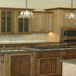 Rustic detailing brings charm to this Chicago kitchen remodeling project by Home Services Direct.