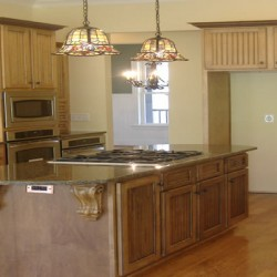 This island brings prep space and a large stove to this Chicago kitchen remodel by Home Services Direct.