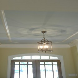 Light fixtures are statement pieces in this Chicago home remodeling project by Home Services Direct.