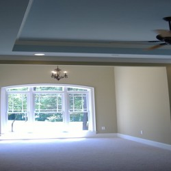 Ceiling design separates this space in this Chicago home remodeling project by Home Services Direct.