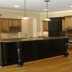 A large island allows for bar seating in this kitchen remodeling project by Home Services Direct in Chicago.
