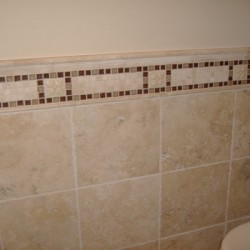 Tile detailing brings character to this Home Services Direct bathroom remodel in Chicago.