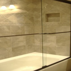 Beautiful detailing makes the shower the focal point of this Home Services Direct bathroom remodel in Chicago.