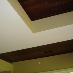 A dramatic ceiling design brings contrast into this house remodeling project by Home Services Direct in Chicago.