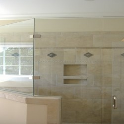 A unique shape means a massive shower in this Chicago bathroom remodeling project by Home Services Direct.
