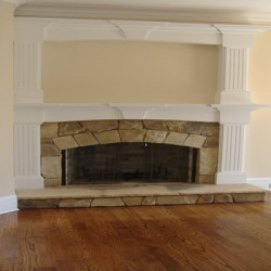 This unique fireplace design adds natural beauty to this Chicago house remodeling project by Home Services Direct.