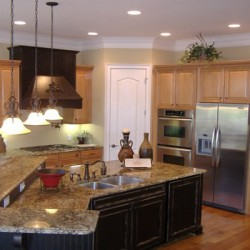 Recessed lighting brings a modern touch to this Chicago kitchen remodeling project by Home Services Direct.