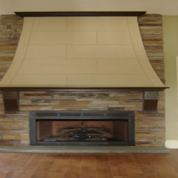 This dramatic fireplace design is the focal point of this Chicago house remodeling project by Home Services Direct.