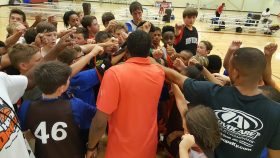 team huddling up at Hoop Dreams youth basketball camp