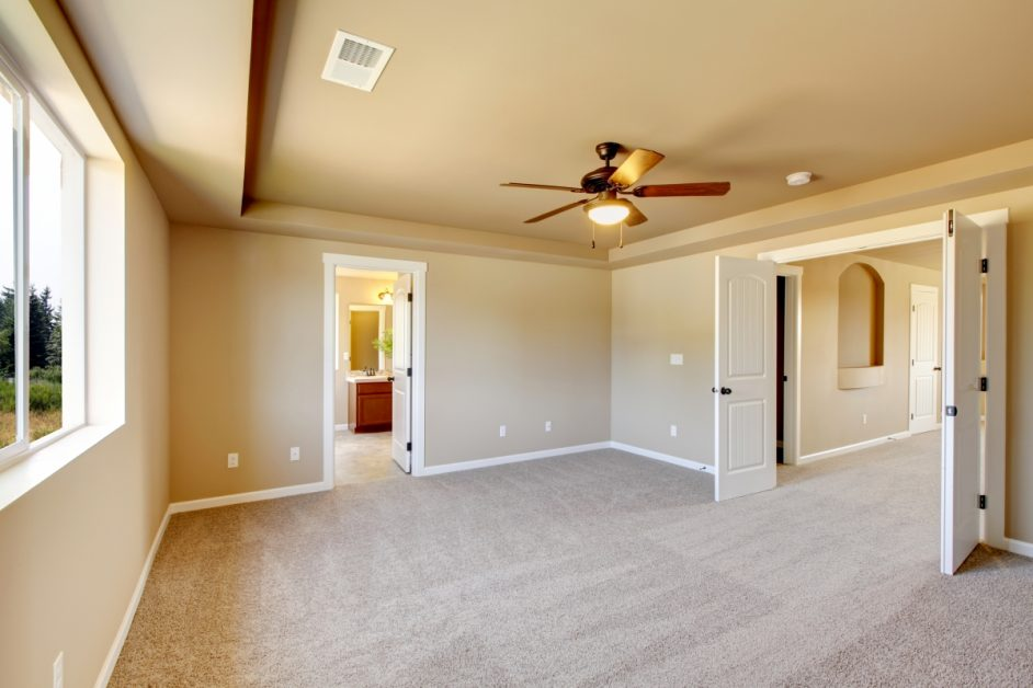 Clean Unfurnished Room With Beige Walls