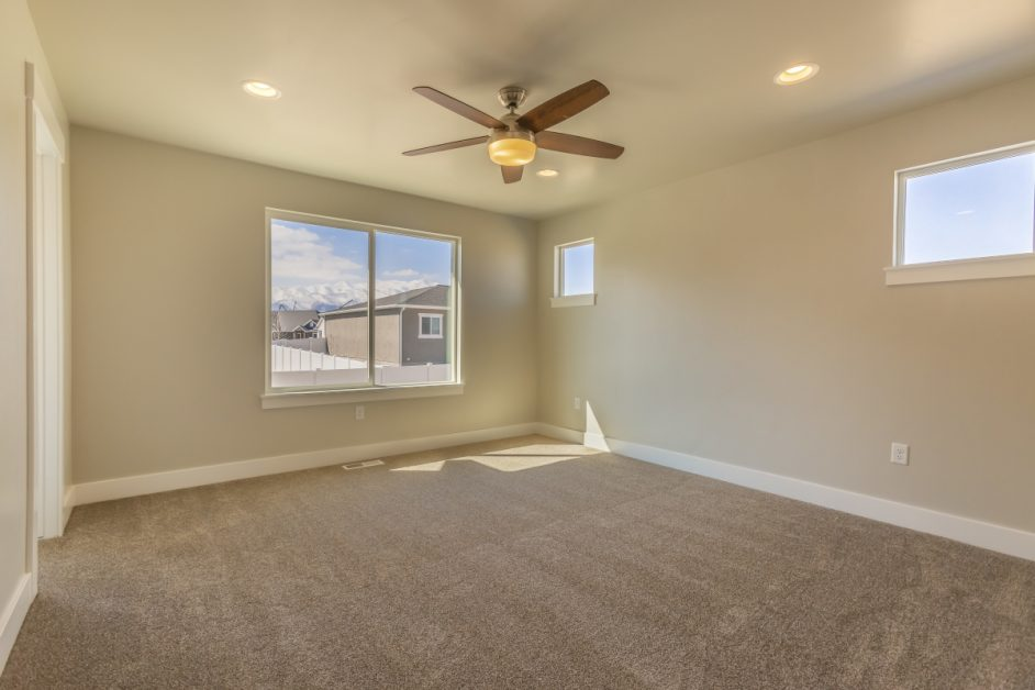 Clean Unfurnished Room With Tan Painted Walls
