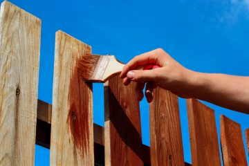 Applying Stain to a Fence