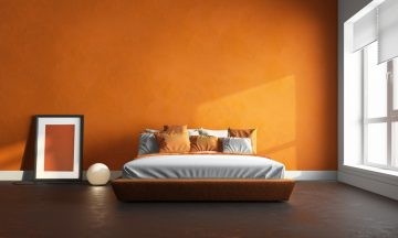 Simple Bedroom With an Orange Wall