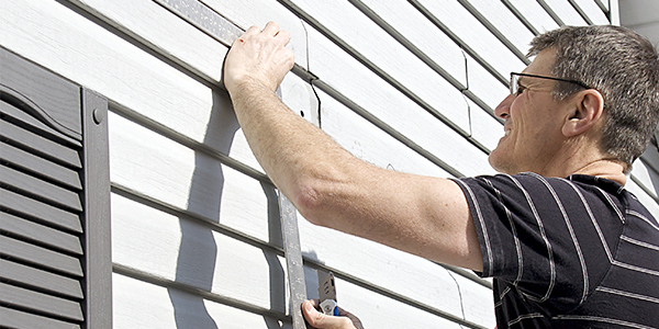 Worker Installing Siding