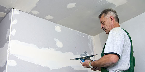 Worker Installing Drywall