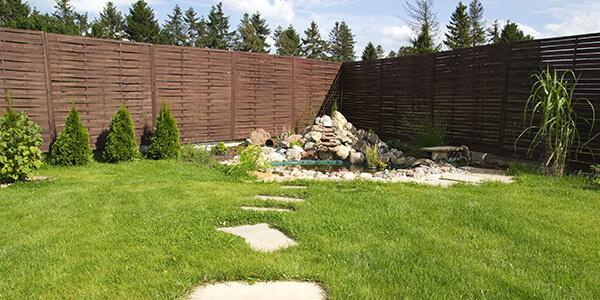 Freshly Stained Cedar Fence