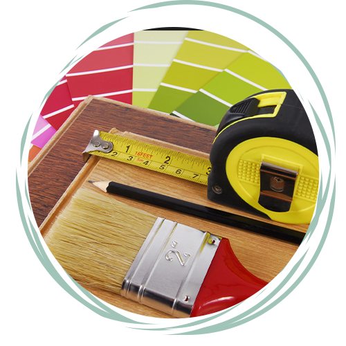 Paint chips, tape measure, paint brush, and a pencil to plan for a paint job.