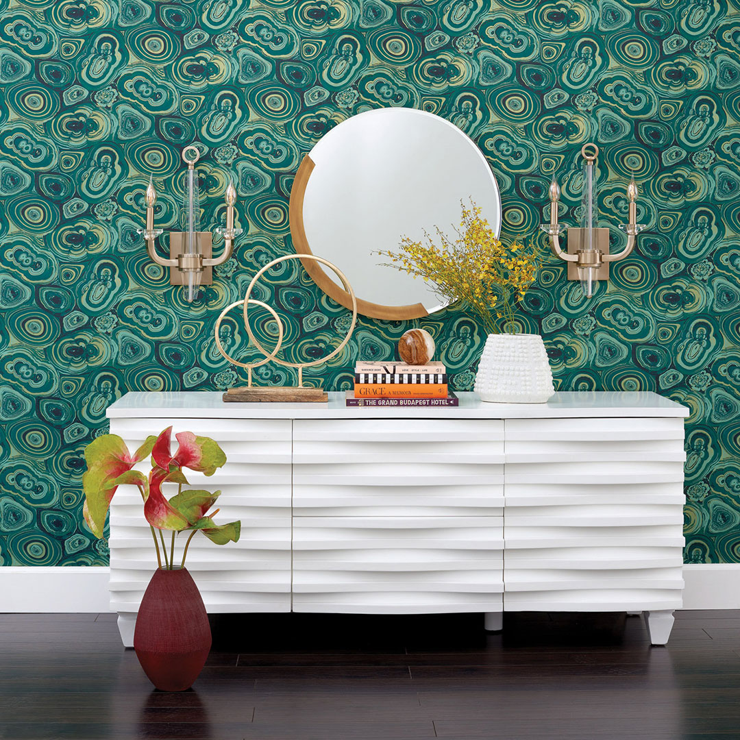 Geo design wall paper with gold candelabra wall lighting