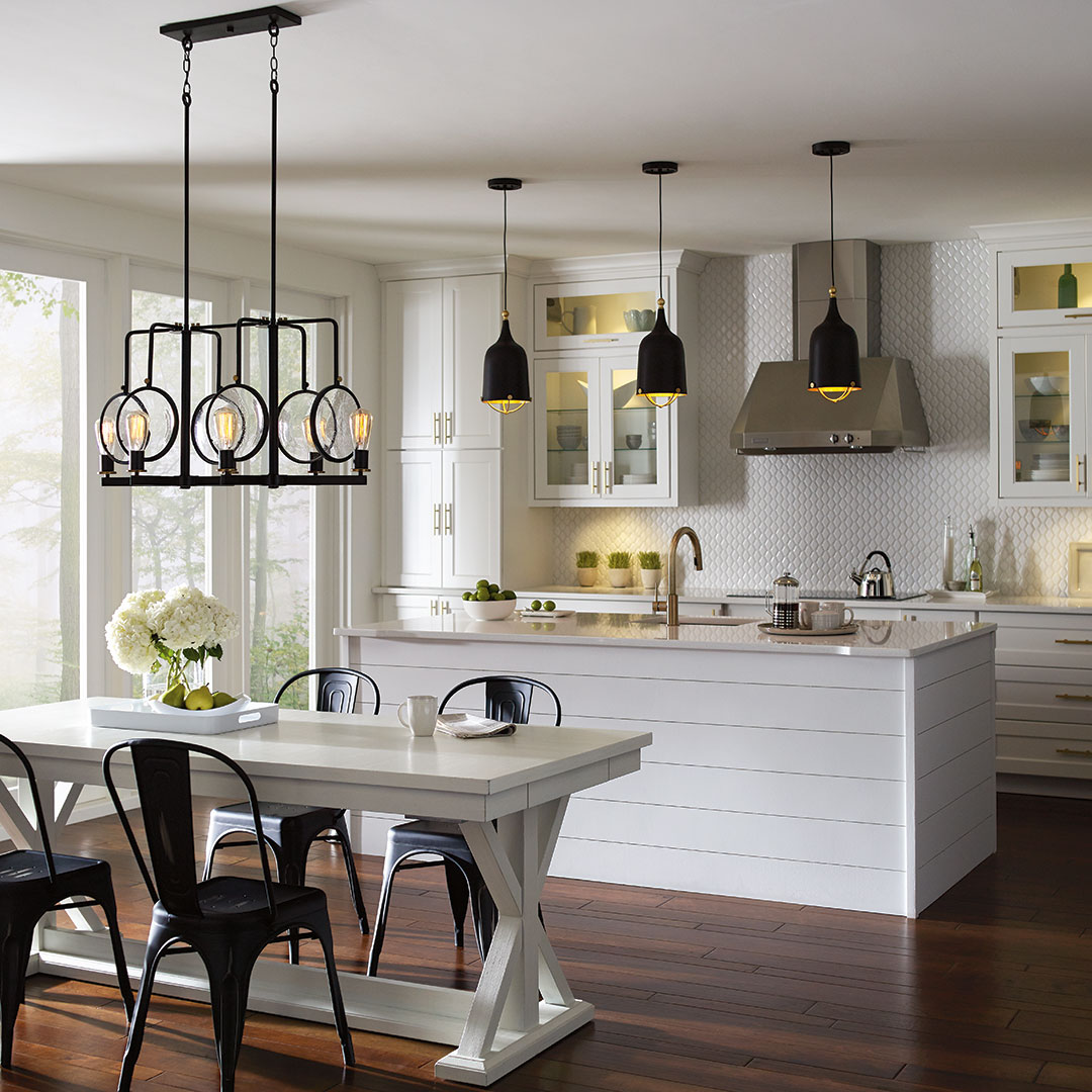 Black pendants in white kitchen