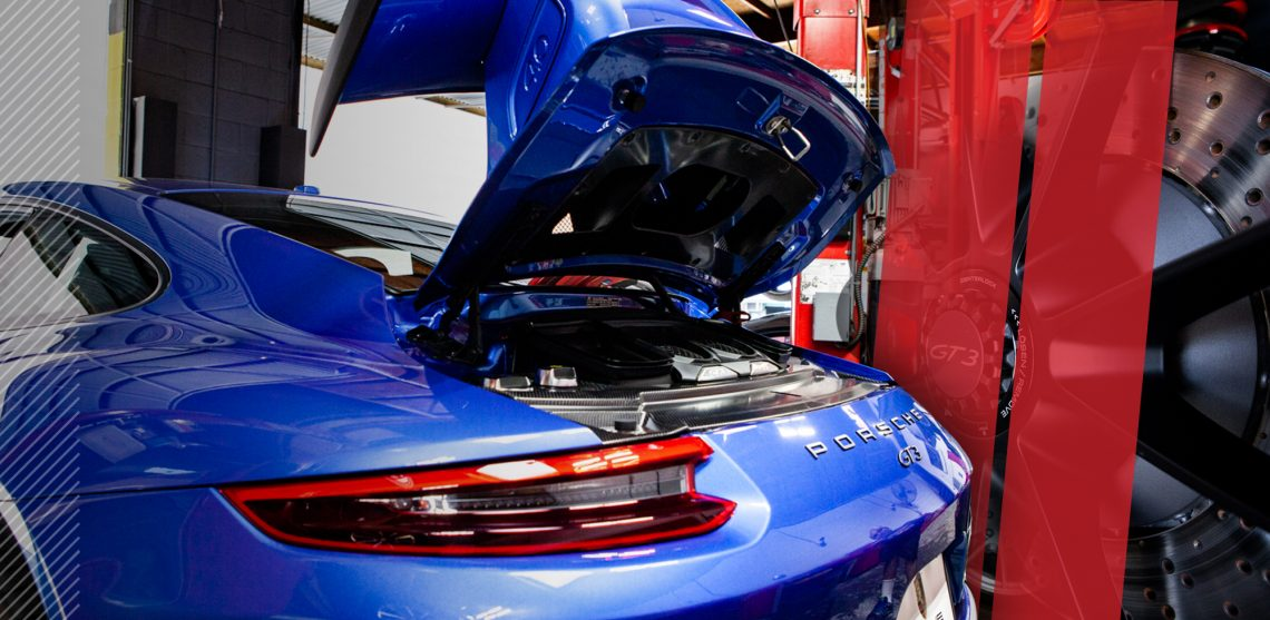 A blue Porsche in the shop at HOUSE Auto in Pasadena.