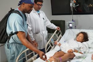 Dr. Rahman helping kids in Colombia