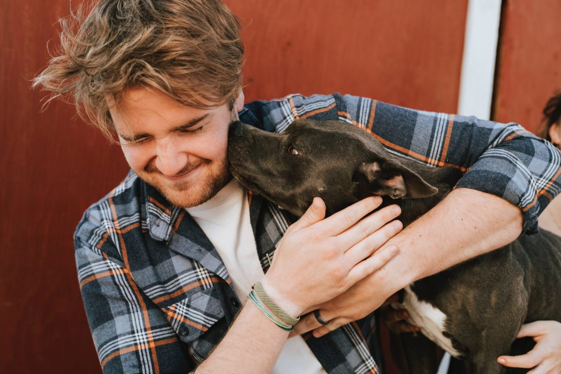 pet sitter smiling with dog